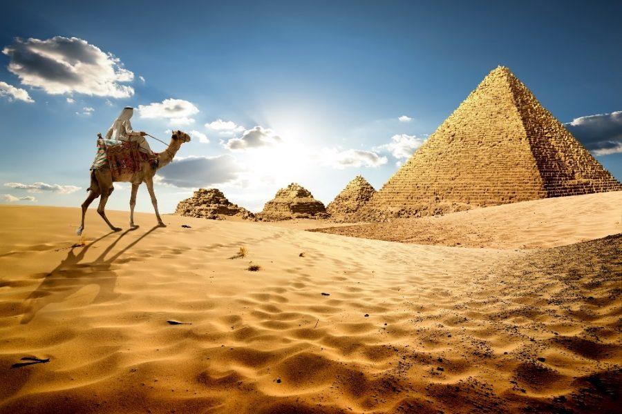 Bedouin-on-camel-near-pyramids-in-desert_edited